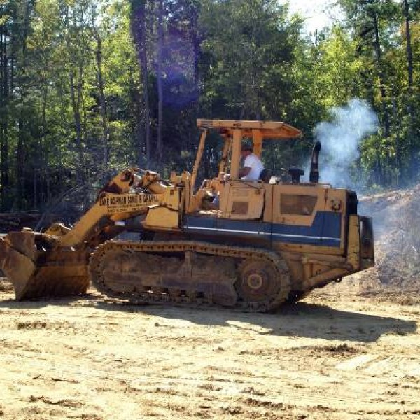 We provide quick grading and landscaping with our bulldozer.